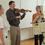 Noah and Tatjana sing with St. Anna's music therapist